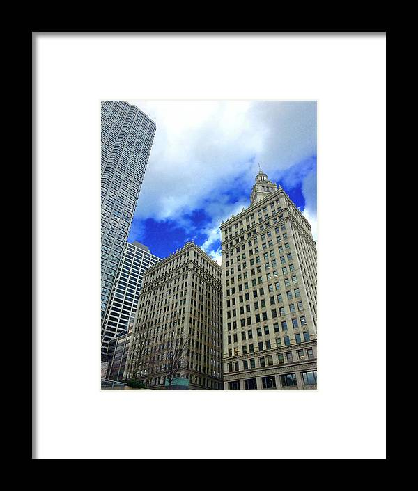 Wrigley Building Framed Print featuring the photograph Carried Away by Margaret Fronimos