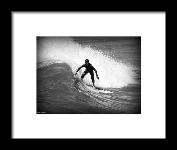 Surfing Framed Print featuring the photograph Catching A Wave by Mariecor Agravante