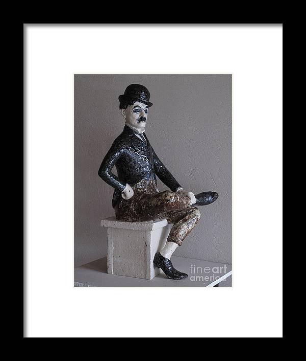 Charlie Chaplin Framed Print featuring the sculpture Charlie Chaplin by Raimonda Jatkeviciute-Kasparaviciene