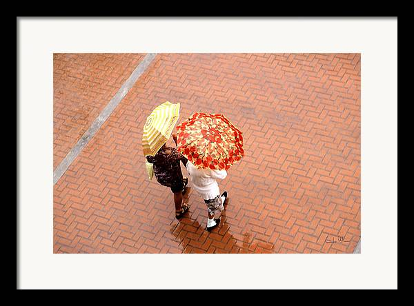 Rain Framed Print featuring the photograph Chatting In The Rain - Umbrellas Series 1 by Carlos Alvim