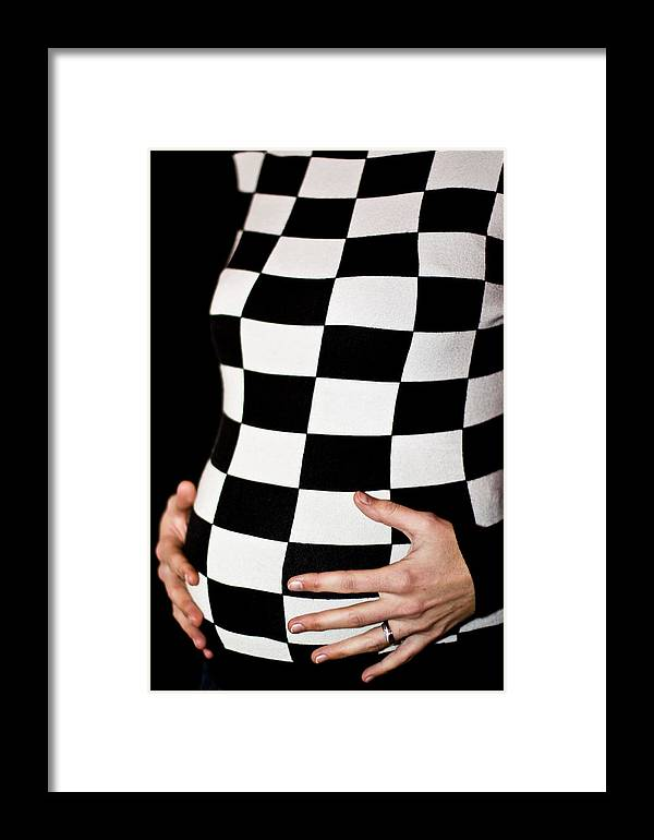 Black Framed Print featuring the photograph Chequered Pregnancy by Gabor Pozsgai