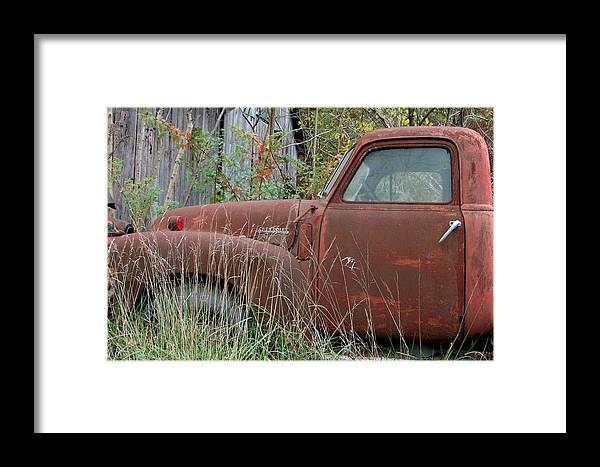 Rustic Fine Art Framed Print featuring the photograph Chevy Truck Rusting Along Road by George Ferrell