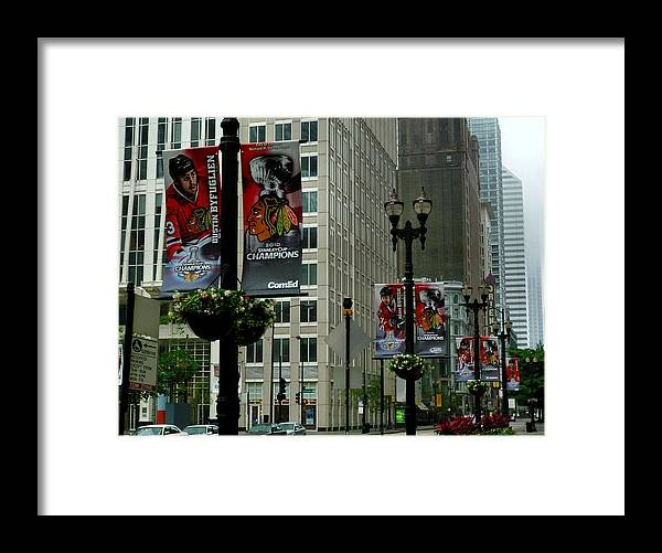Chicago Blackhawk Flags Framed Print featuring the photograph Chicago Blackhawk Flags by Ely Arsha