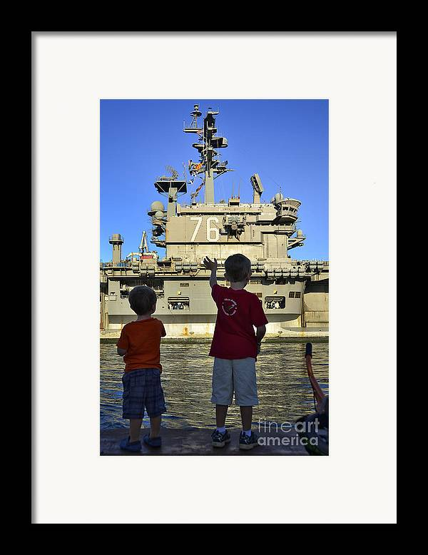 Aircraft Carrier Framed Print featuring the photograph Children Wave As Uss Ronald Reagan by Stocktrek Images