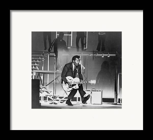 History Framed Print featuring the photograph Chuck Berry B. 1926 On Stage, Playing by Everett
