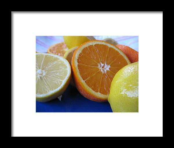 Citrus Framed Print featuring the photograph Citrus On Blue Plate by Kim Pascu