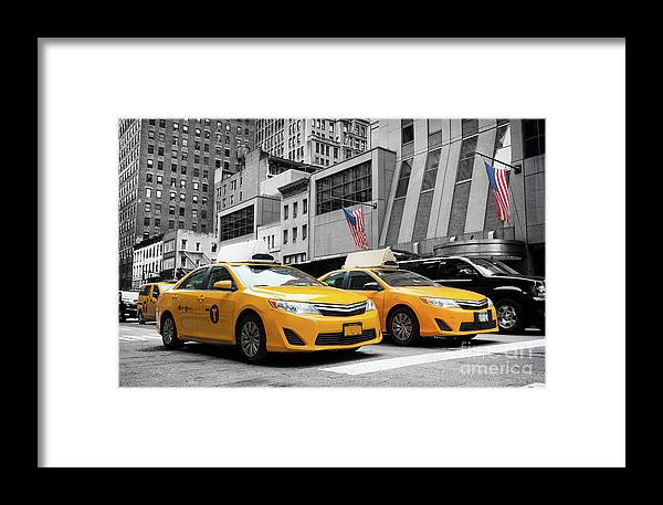 Street Framed Print featuring the photograph Classic Street View Of Yellow Cabs In New York City by Antonio Gravante