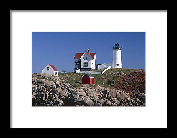 Architecture Framed Print featuring the photograph Close Up View Of A Lighthouse Cape Neddick Maine by George Oze