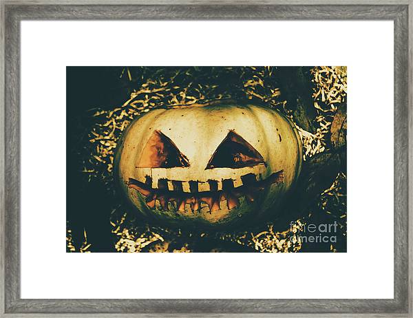 Haunted Framed Print Featuring The Photograph Closeup Of Halloween Pumpkin With Scary Face By Jorgo Photography Wall View 001