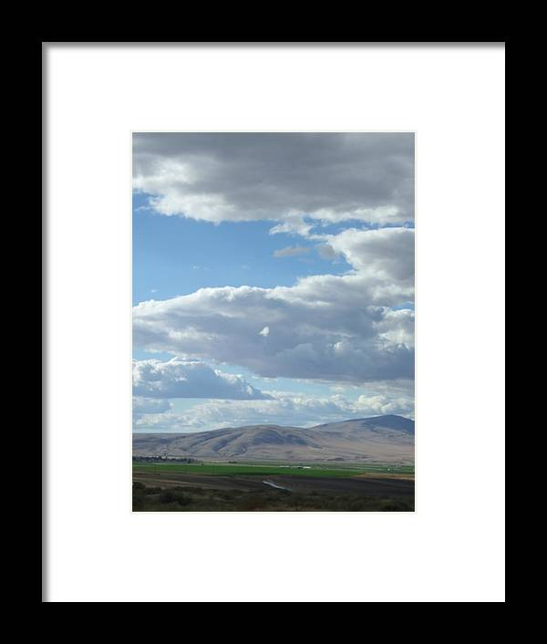 Clouds Framed Print featuring the photograph Cloudbreaks Over Rattlesnake by Ruth Stromswold