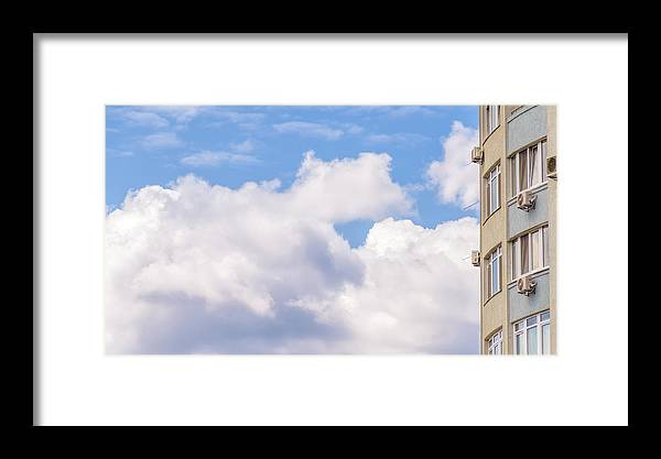 Apartment Framed Print featuring the photograph Clouds And Buildings by Alain De Maximy