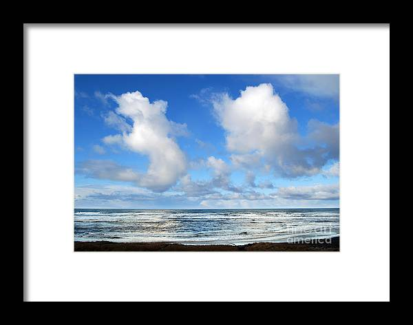 Ocean Framed Print featuring the photograph Clouds At Play by Larry Keahey