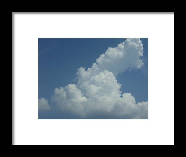 Clouds Framed Print featuring the photograph Clouds by Kristen Hurley