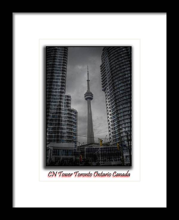 Cityscape Framed Print featuring the photograph Cn Tower by Alyx Mitchell