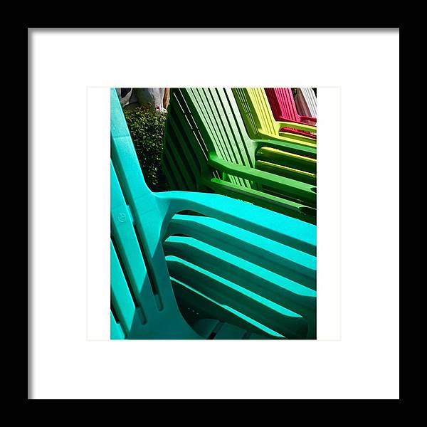 Juansilvaphotos Framed Print featuring the photograph Colorful Stacked Plastic Chairs In by Juan Silva