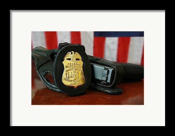 History Framed Print featuring the photograph Contemporary Fbi Badge And Gun by Everett