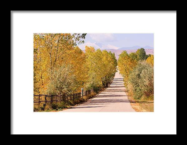 Longs Peak Framed Print featuring the photograph Country Road Autumn Fall Foliage View Of The Twin Peaks by James BO Insogna