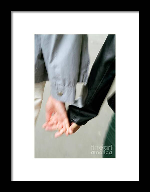 Adult Framed Print featuring the photograph Couple Holding Hands While Strolling Down The Street by Sami Sarkis