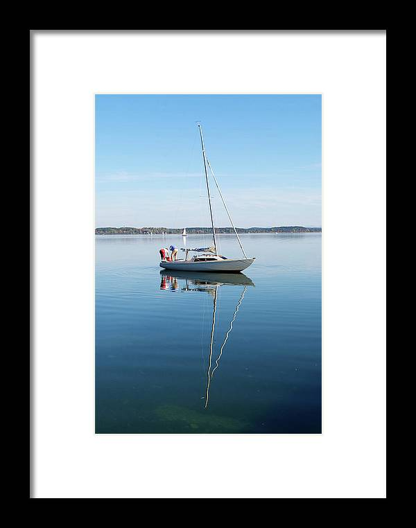 Scene Framed Print featuring the photograph Couple Prepare Sailing Boat In Chiemsee Lake In Germany by Jirawat Cheepsumol