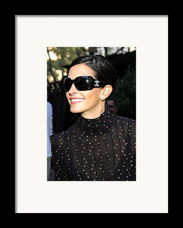 Kinerase Pro+therapy Skin Care Framed Print featuring the photograph Courteney Cox Wearing Chanel Sunglasses by Everett