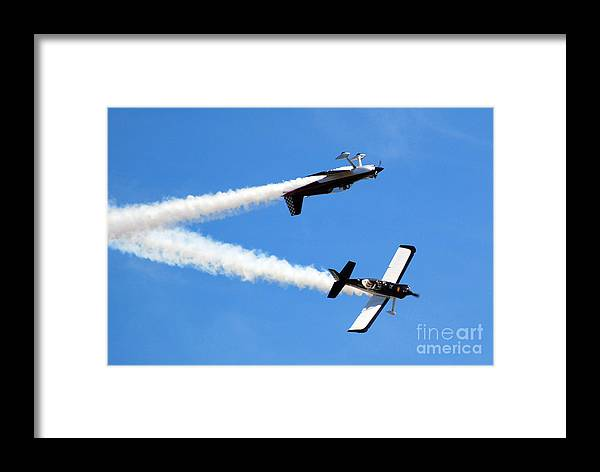 Airplanes Framed Print featuring the photograph Crossing Paths by Larry Keahey