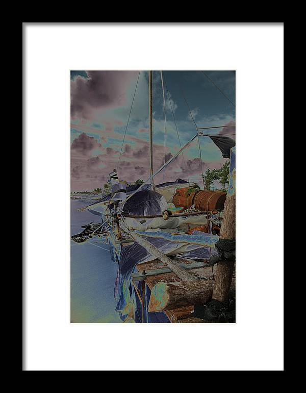 Beach Scape Framed Print featuring the photograph Cuban Refugee Raft 3 by Susan Garrett