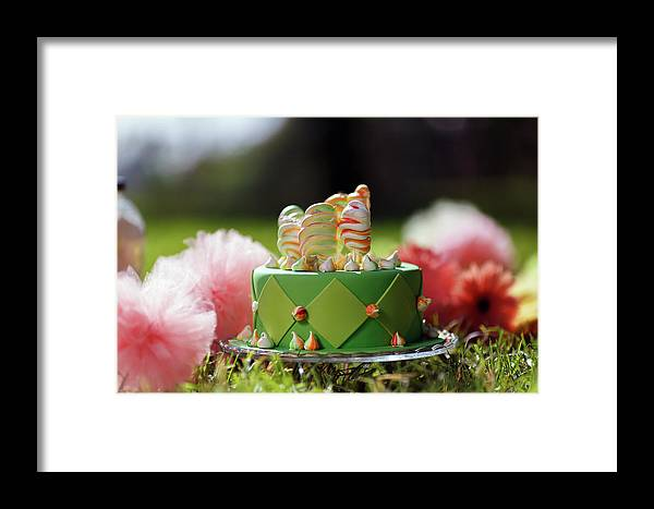 Background Framed Print featuring the photograph Cupcake With Green Icing And Happy St-pat's Day Written On It. by Jan Pavlovski