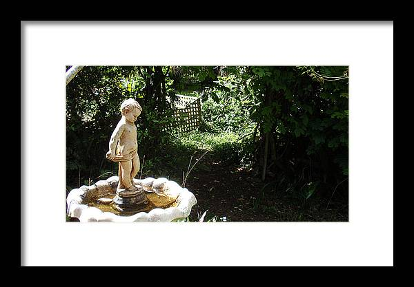 Cupid Framed Print featuring the photograph Cupid Of The Garden by Edan Chapman