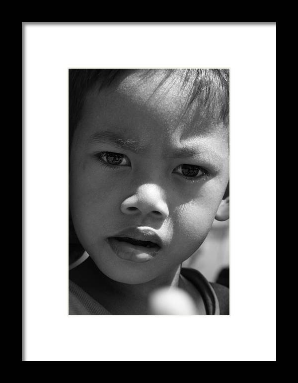 B&w black & White Child Cambodian Curious Framed Print featuring the photograph Curious Cambodian Child by Linda Russell