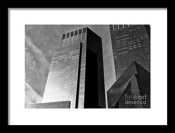 Dark Giants Along Central Park West Framed Print featuring the photograph Dark Giants Along Central Park West by John Rizzuto