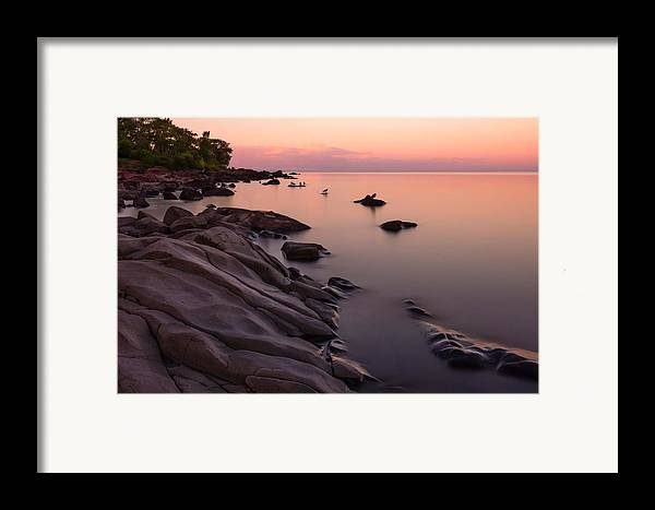 dimming Of The Day a Wonderful Song By Bonnie Raitt sunset Calm Peace Serenity lake Superior lake Superior Sunset brighton Beach Duluth Minnesota Nature long Exposure lake Superior Northshore ancient Rocks magic Framed Print featuring the photograph Dimming Of The Day by Mary Amerman