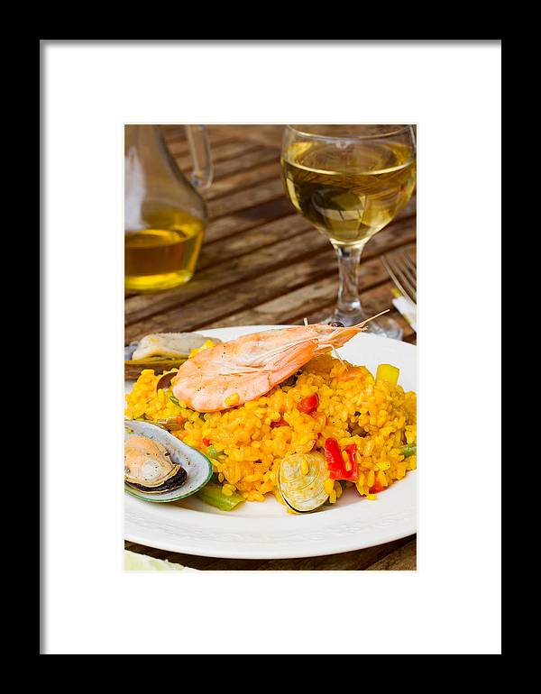 Paella Framed Print featuring the photograph Dining With Paella by Anastasy Yarmolovich