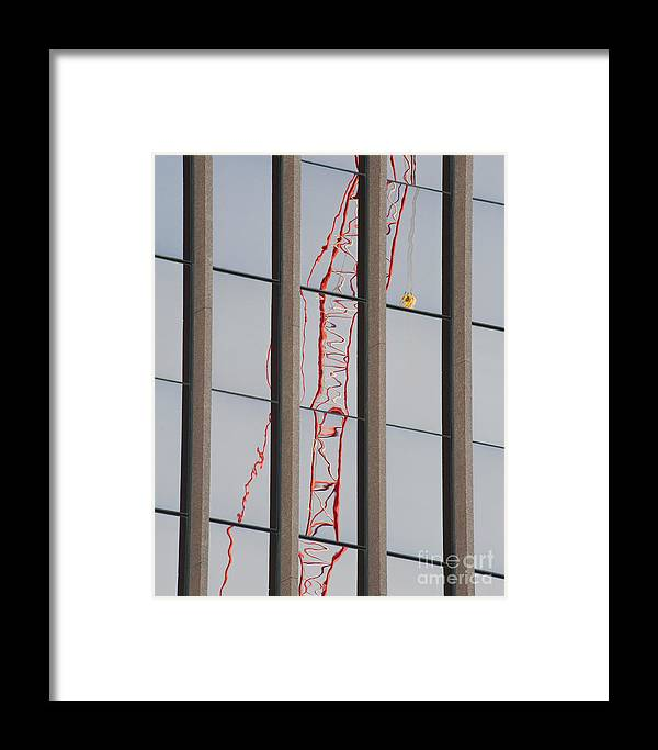 Distorted Reflection Of A Tower Crane Framed Print