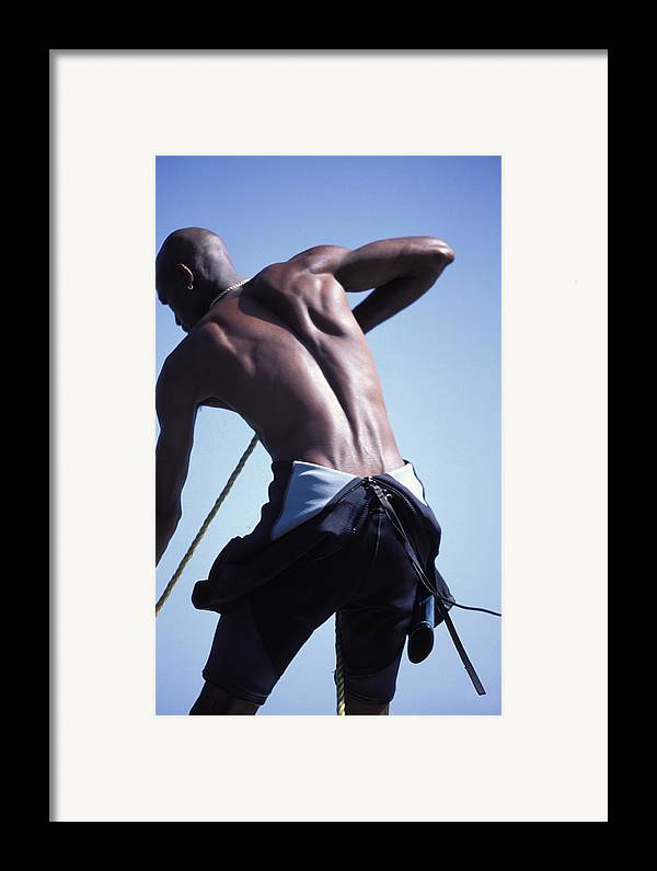 Muscular Framed Print featuring the photograph Diveboat Captain In The Caribbean by Carl Purcell