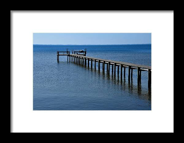 Dock Framed Print featuring the photograph Dock Fisherman by Lyle Huisken