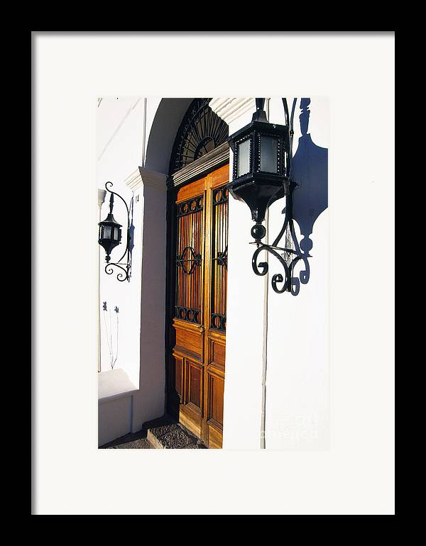 Wooden Door Framed Print featuring the photograph Door And Lamps by Thomas R Fletcher
