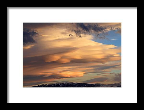 Lenticular Clouds Framed Print featuring the photograph Dreamy Sunset by Donna Kennedy