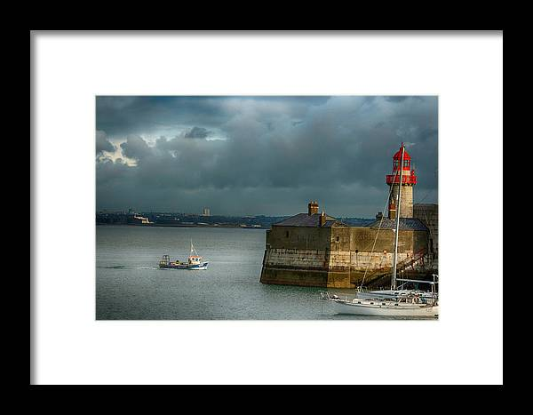 Dun Laoghaire Framed Print featuring the photograph Dun Laoghaire Harbor Lighthouse by Larry Pegram