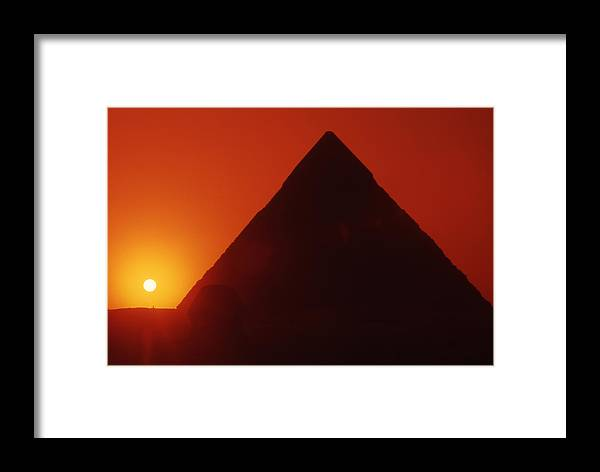 Ancient; Antiquity; Antiquated; Archaeology; Archaelogical; Atmospheric; Egypt Framed Print featuring the photograph Egypt. Sunset Behind The Sphinx And Chephren Pyramid. by Steve Outram