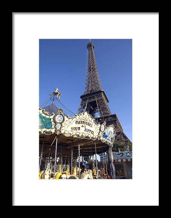 Eiffel Tower Framed Print featuring the photograph Eiffel Tower And Ancient Carousel by Charles Ridgway
