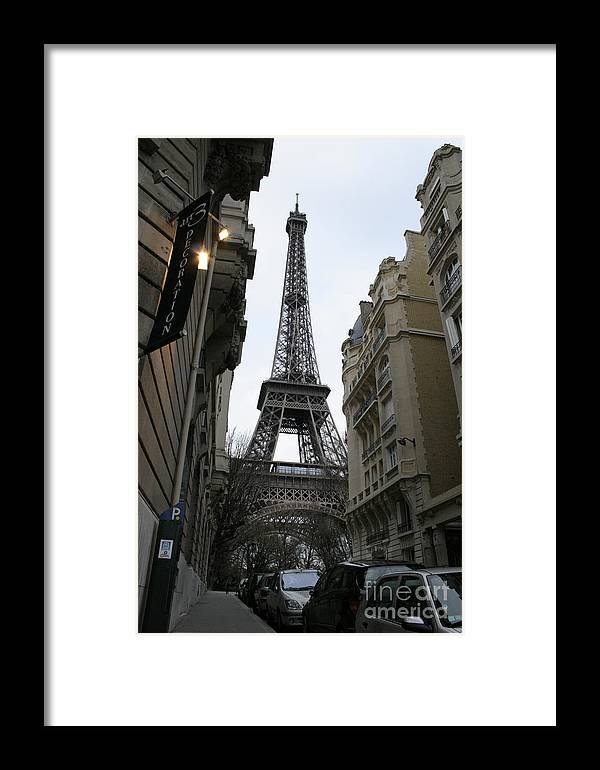 Eiffel Tower Framed Print featuring the photograph Eiffel Tower Through A Concrete Forest by Joshua Francia