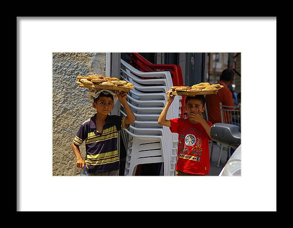 Child Framed Print featuring the photograph Ekmek For Sale by Don Prioleau