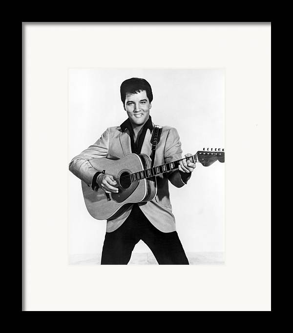 1950s Portraits Framed Print featuring the photograph Elvis Presley, C. Mid-1960s by Everett