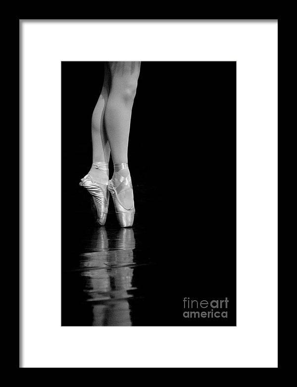 Pointe Framed Print featuring the photograph En Pointe by Jeannie Burleson
