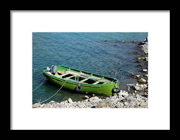 Satpara Framed Print featuring the photograph Faded Green Yellow Motor Power Boat Parked At Satpara Lake Pakistan by Imran Ahmed