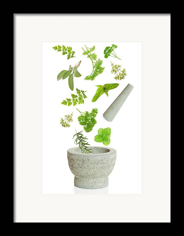 Pestle Framed Print featuring the photograph Falling Herbs by Amanda Elwell