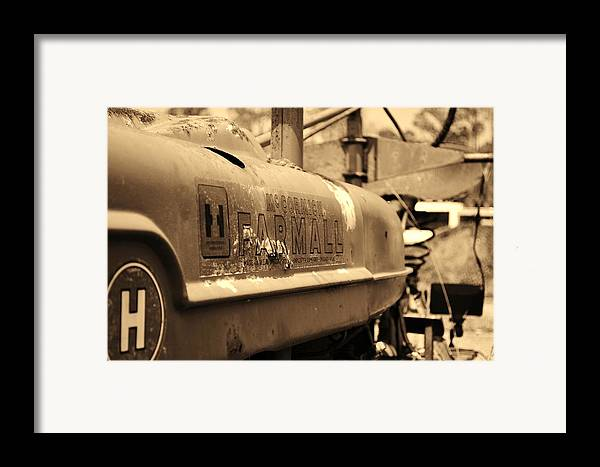 Farmall Framed Print featuring the photograph Farmall Logo In Sepia by Lynda Dawson-Youngclaus