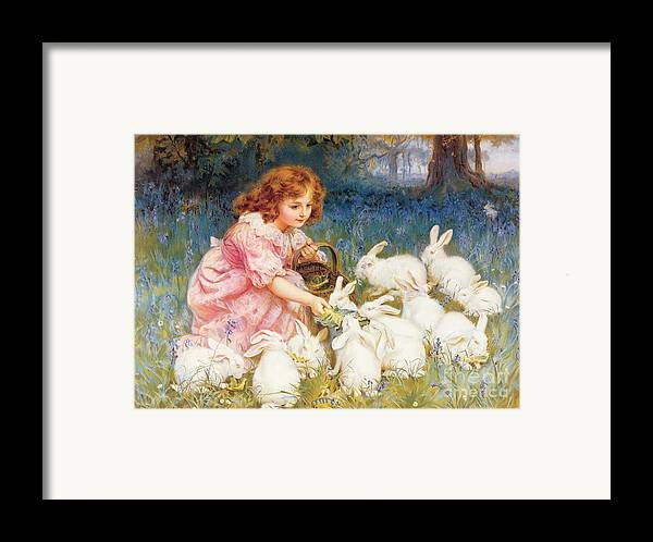 Feeding Framed Print featuring the painting Feeding The Rabbits by Frederick Morgan