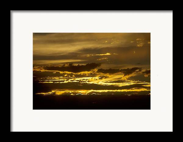 Clouds Framed Print featuring the photograph Fire In The Sky by Lynard Stroud