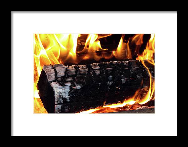 Firewood Framed Print featuring the photograph Fire On Wood by Jay Anthony